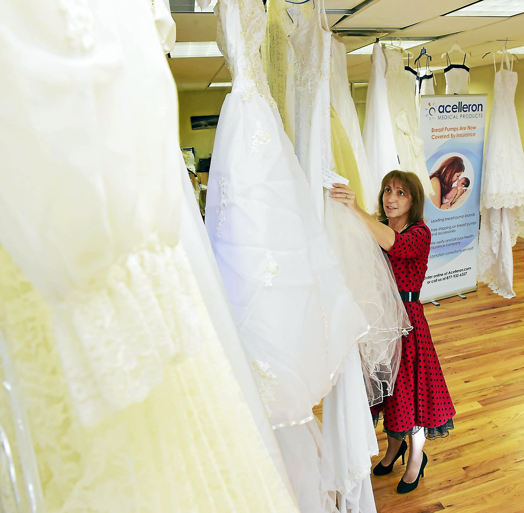 Employee in Guilford repurposes wedding gowns to provide comfort to ...