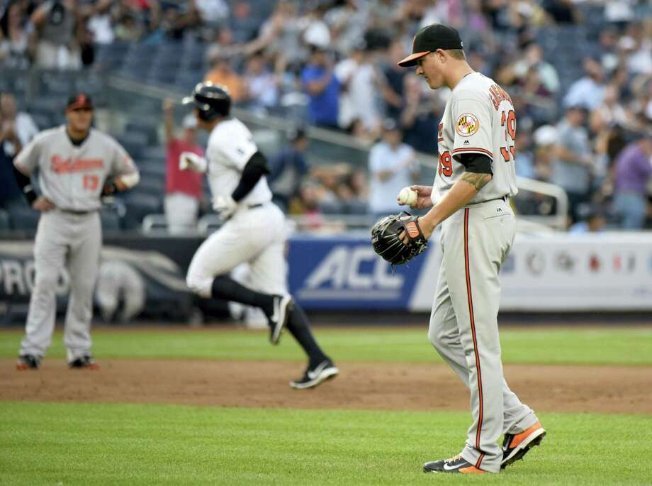 Orioles pitcher Kevin Gausman, right, reacts as Alex Rodriguez rounds the bases after hitting a home run in the second inning on Monday. Photo: Bill Kostroun — The Associated Press   / FR51951 AP