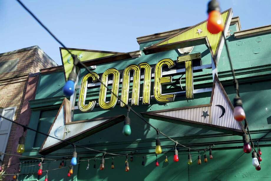 "The front door of Comet Ping Pong pizza shop in Washington. A fake news story prompted a man to fire a rifle inside a popular Washington, D.C., pizza place as he attempted to ""self-investigate"" a conspiracy theory that Hillary Clinton was running a child sex ring from there, police said. Photo: Jose Luis Magana — AP Photo / FR159526 AP"