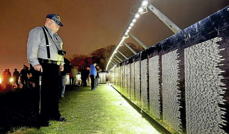 "West Haven Vietnam veteran Peter ""Doc"" Wight, who served in the Air Force 31st Tactical Fighter Wing in Homestead, Florida, from 1971 to 1977, visits The Wall That Heals at Bradley Point in West Haven during an opening ceremony Thursday. Photo: Catherine Avalone — New Haven Register   / New Haven RegisterThe Middletown Press"