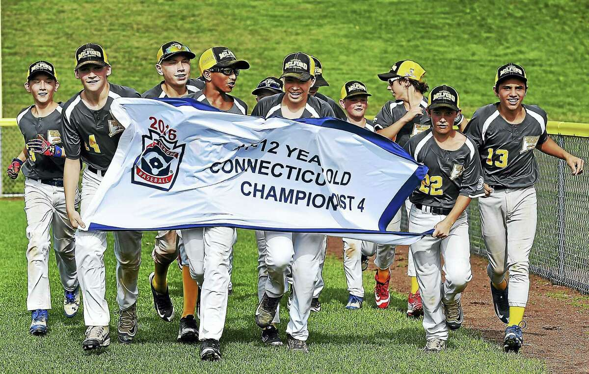 Milford runs their victory lap after defeating West Haven, 16-11, in the U12 District 4 Little League Championship game this weekend at the Edward C. Wall Little League Field in North Branford.