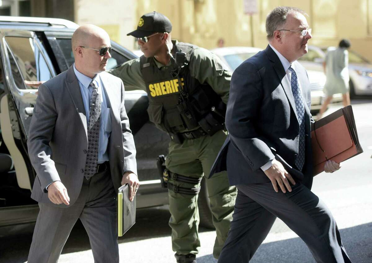 Lt. Brian Rice, left, one of the six members of the Baltimore Police Department charged in connection to the death of Freddie Gray, arrives with attorney Mike Davey, right, at a courthouse to hear a judge's ruling in his trial in Baltimore on Monday, July 18, 2016. Rice is the fourth of the six officers charged to go on trial in the 2015 death of Freddie Gray.
