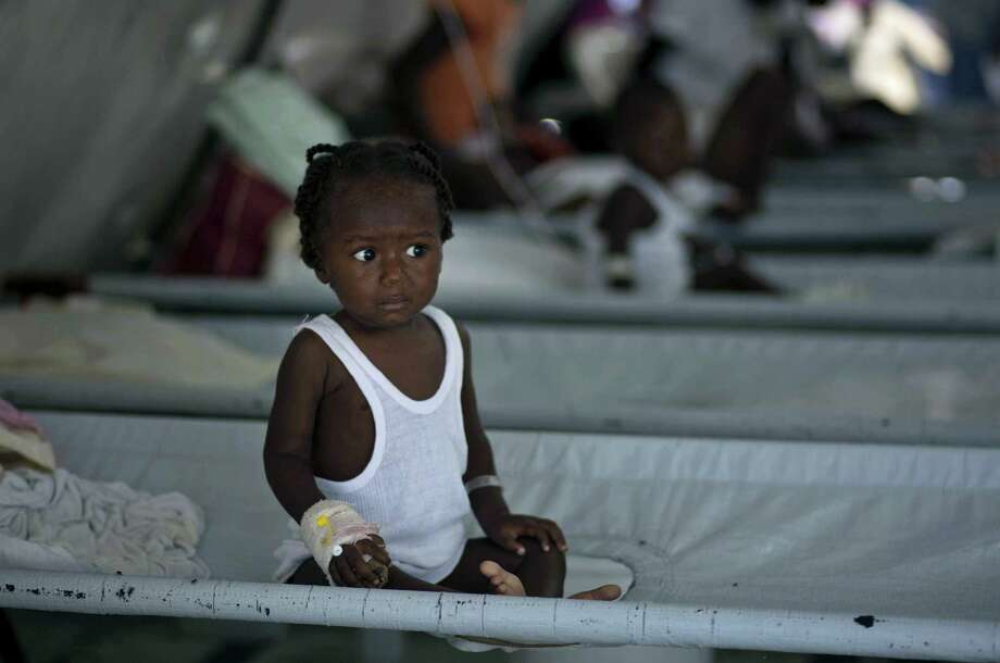 A girl receives treatment for cholera symptoms at a Doctors Without Borders, MSF, cholera clinic in Port-au-Prince, Haiti. Photo: AP FILE Photo   / AP2011