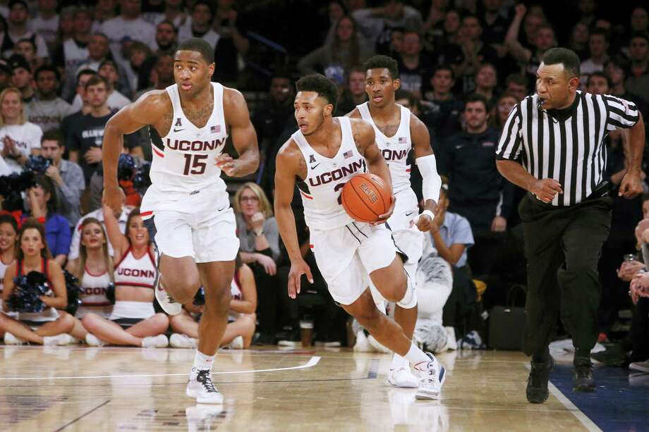 UConn's Jalen Adams (2) advances the ball with teammates Rodney Purvis (15) and Christian Vital (1) against Syracuse on Monday. Photo: The Associated Press    / FR103966 AP