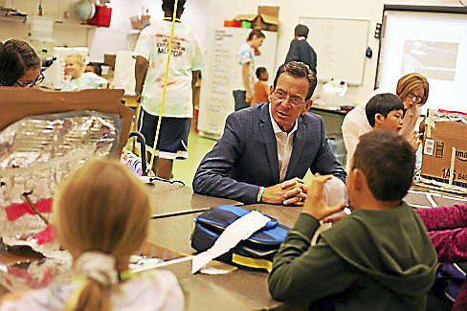 Gov. Dannel P. Malloy talks to youngsters Friday at the Connecticut Science Center Photo: CHRISTINE STUART — CTNEWSJUNKIE