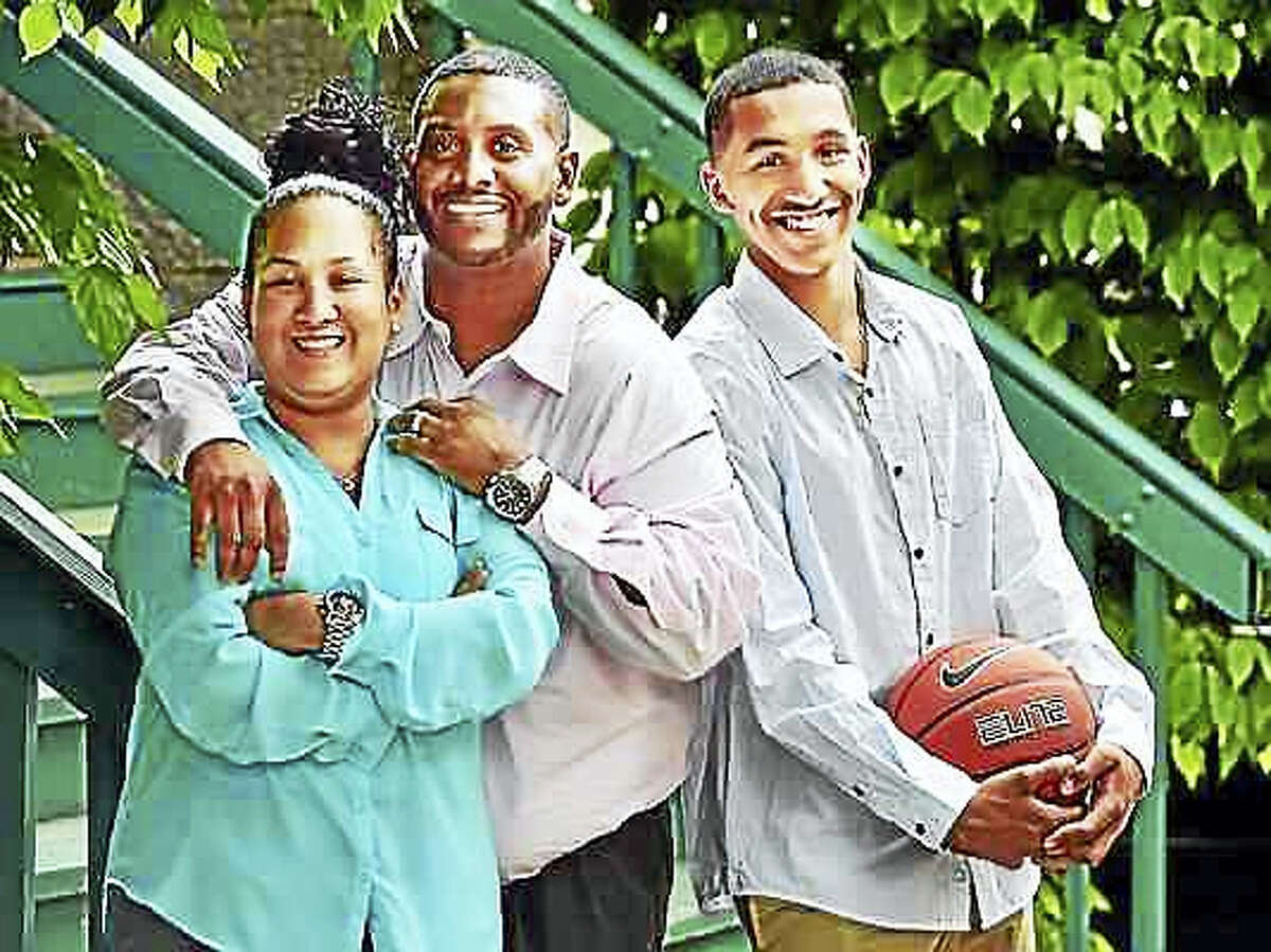 From left, Vanessa, Edward and Tremont Waters, 17, of New Haven. Tremont Waters has transferred to Notre Dame-West Haven for his senior season.