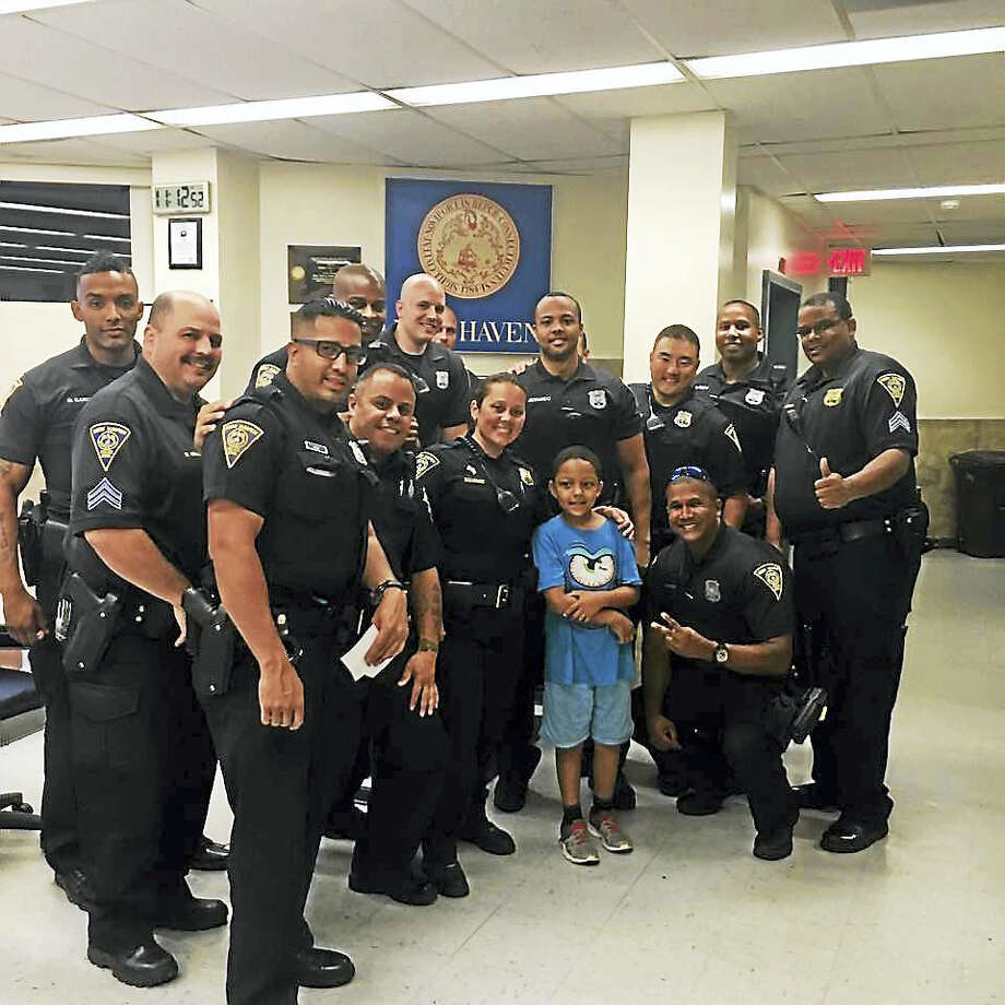 Jayson, 7, with New Haven police officers earlier this month. Photo: CONTRIBUTED PHOTO