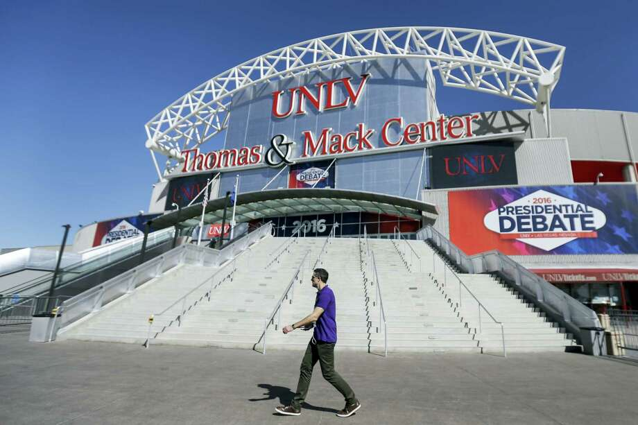 A pedestrian walks past the site for the third presidential debate between Republican presidential nominee Donald Trump and Democratic presidential nominee Hillary Clinton at UNLV in Las Vegas on Oct. 18, 2016. Photo: AP Photo/Julio Cortez   / Copyright 2016 The Associated Press. All rights reserved.