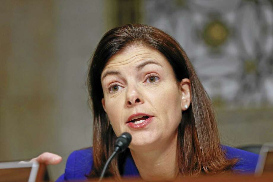 FILE - Senate Armed Services Committee member Sen. Kelly Ayotte, R-N.H., questions former Nebraska Republican Sen. Chuck Hagel, President Obama's choice to lead the Pentagon, during his confirmation hearing on Capitol Hill in Washington, in this Jan. 31, 2013 file photo. A woman whose mother was killed in last year's school shooting in Newtown, Conn., confronted Sen. Kelly Ayotte Tuesday April 30, 2013 during the senator's first public appearance in New Hampshire since voting against gun control legislation.  (AP Photo/J. Scott Applewhite, File) Photo: AP / AP