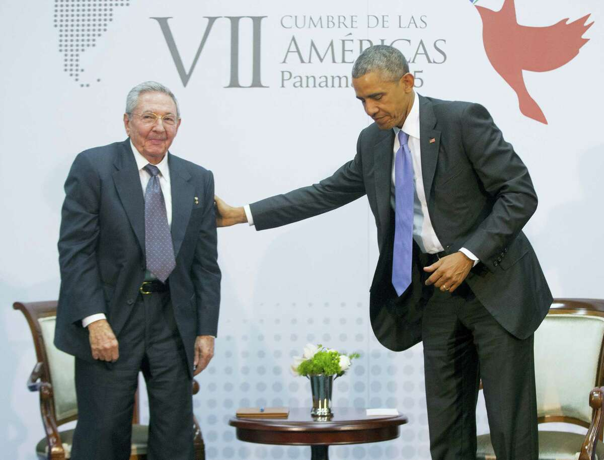 U.S. President Barack Obama with Cuban President Raul Castro during their meeting at the Summit of the Americas in Panama City, Panama, April 11, 2015.