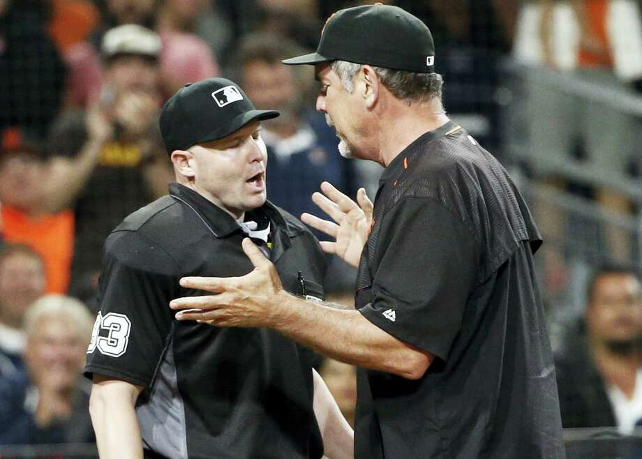 Giants manager Bruce Bochy argues with umpire Mike Estabrook during a recent game. Photo: Lenny Ignelzi — The Associated Press   / Copyright 2016 The Associated Press. All rights reserved. This material may not be published, broadcast, rewritten or redistribu