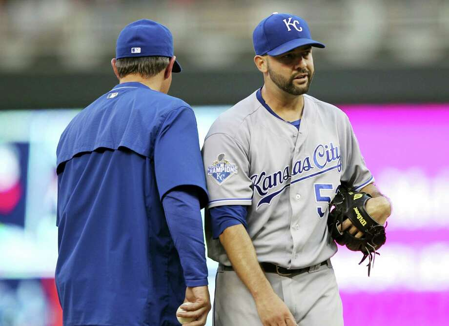 Kansas City Royals manager Ned Yost takes the ball from starting pitcher Dillon Gee during a recent game. Photo: Andy Clayton-King — The Associated Press   / FR51399 AP