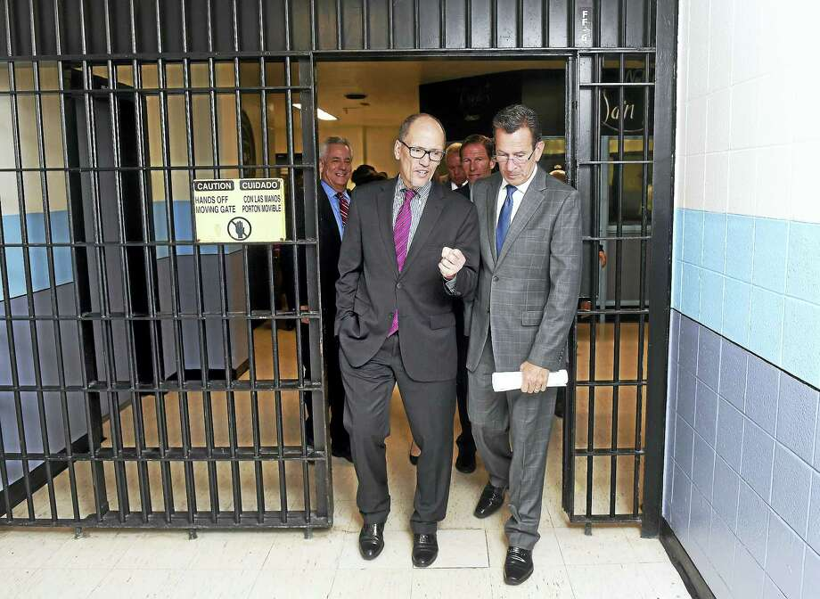 U.S. Secretary of Labor Thomas Perez, left, speaks with Gov. Dannel P. Malloy after meeting with inmates taking part in job training programs at the New Haven Correctional Center Monday. Photo: Arnold Gold — New Haven Register