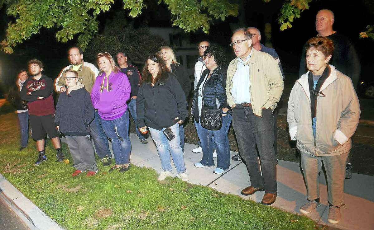 People listen to stories of hauntings on a recent ghost walk through downtown Milford.