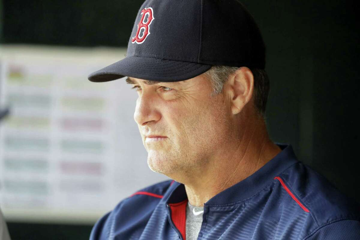 Red Sox manager John Farrell looks on from the dugout in Detroit.