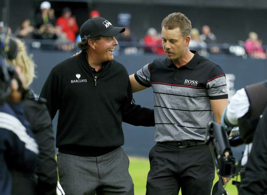 Phil Mickelson, left, congratulates Henrik Stenson for winning the British Open on Sunday. Photo: Matt Dunham — The Associated Press    / Copyright 2016 The Associated Press. All rights reserved. This material may not be published, broadcast, rewritten or redistribu