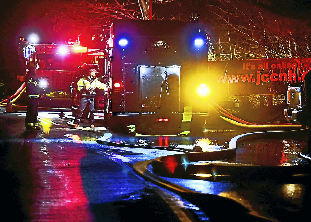 Emergency personnel on the drive leading to the entrance of the Jewish Community Center after a fire Dec. 5.