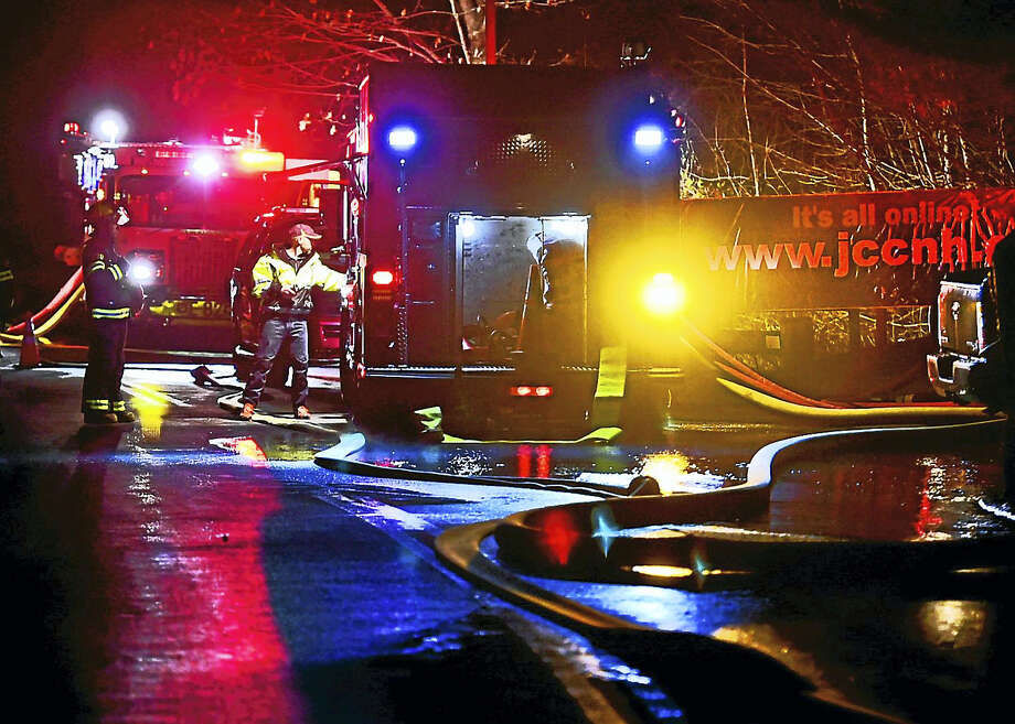 Emergency personnel on the drive leading to the entrance of the Jewish Community Center after a fire Dec. 5. Photo: Peter Hvizdak — New Haven Register   / ?2016 Peter Hvizdak
