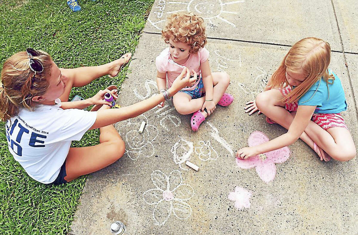 Children draw on the sidewalk in front of City Hall in Milford for Chalk the Walks 2016 on 8/17/2016. Chalk the Walks 2016 is a collaboration between the Milford Prevention Council and the City of Milford and is one of the River Street Wednesday activities.