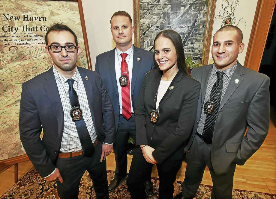 New Haven police Officers Daniel Conklin, Ryan Macuirzynski, Elizabeth White and Nicholas Katz were promoted to detective Friday during a ceremony at New Haven City Hall. Photo: Catherine Avalone — New Haven Register   / New Haven RegisterThe Middletown Press