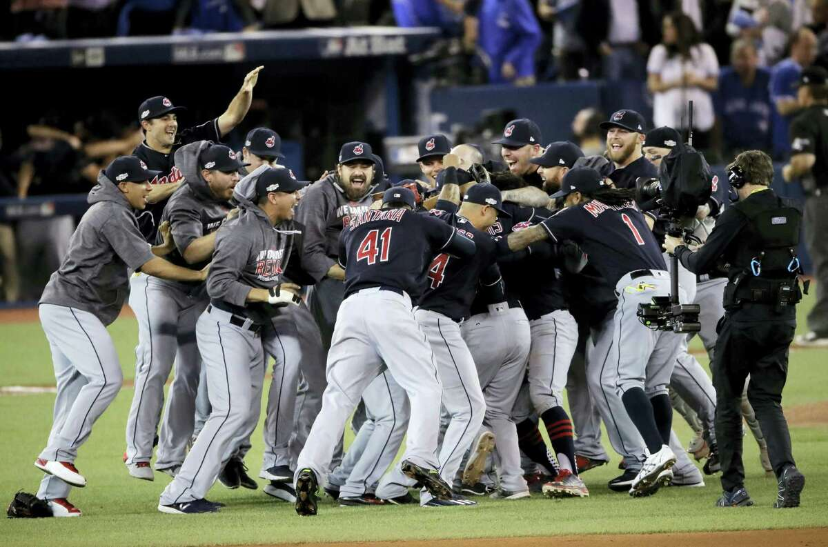 Members of the Cleveland Indians celebrate after their 3-0 win in Game 5 of baseball's American League Championship Series against the Toronto Blue Jays in Toronto Wednesday.
