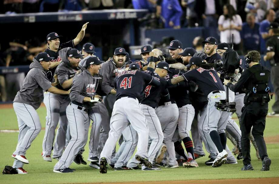 Members of the Cleveland Indians celebrate after their 3-0 win in Game 5 of baseball's American League Championship Series against the Toronto Blue Jays in Toronto Wednesday. Photo: CHARLIE RIEDEL — THE ASSOCIATED PRESS   / Copyright 2016 The Associated Press. All rights reserved.