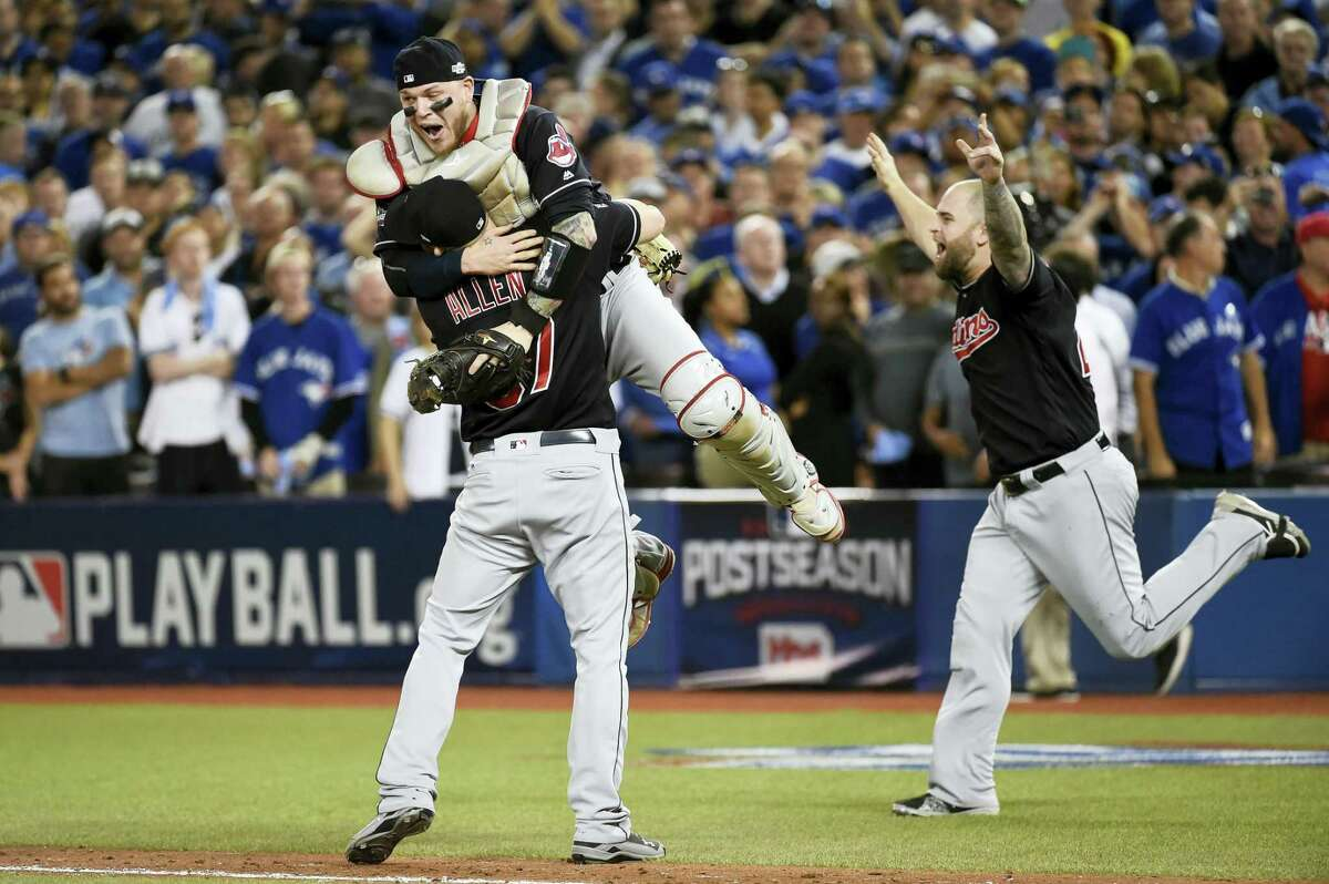 Cleveland Indians Cody Allen (37), Roberto Perez (55) and Mike Napoli (26) celebrate the team's victory over the Toronto Blue Jays. The World Series begins next week.