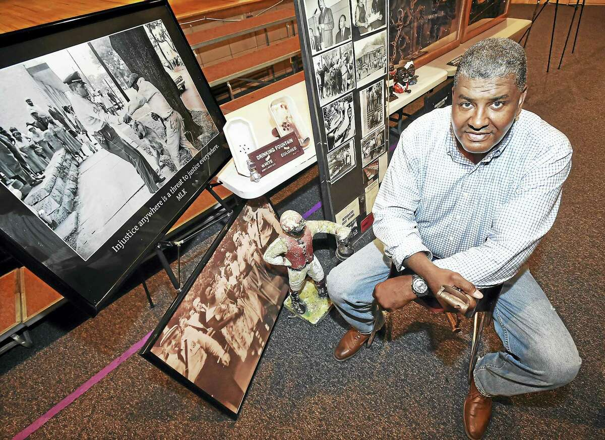 Jeffrey Fletcher, a 21-year veteran of the New Haven Police Department, with his his African American History Exhibit during a public session at Joseph Melillo Middle School in East Haven.