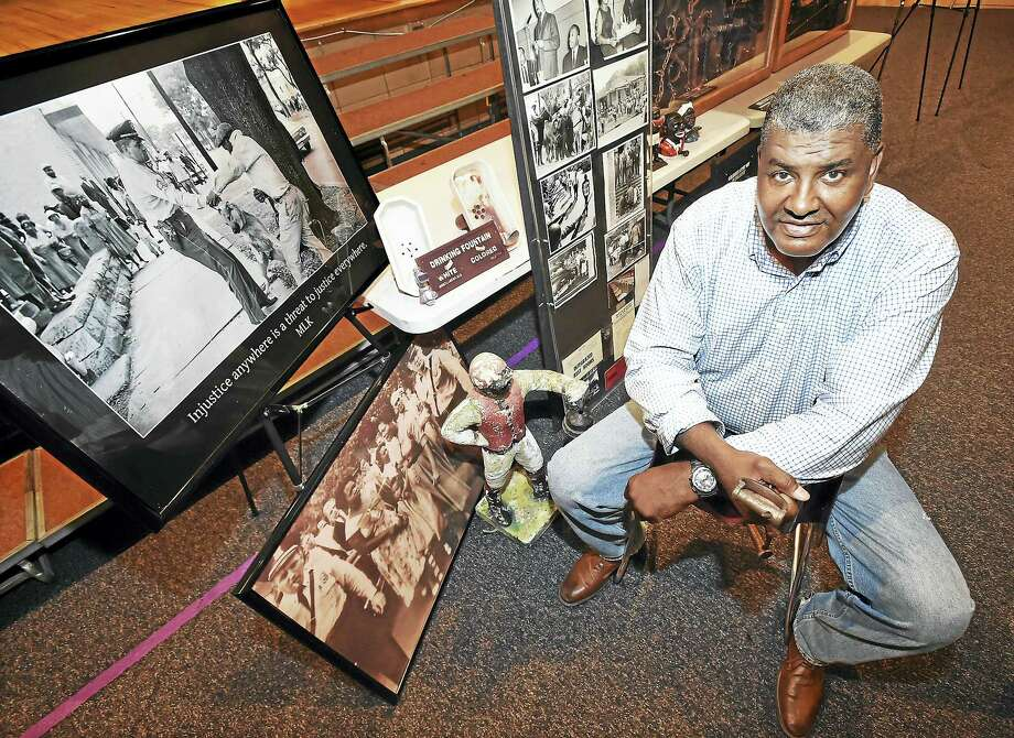 Jeffrey Fletcher, a 21-year veteran of the New Haven Police Department, with his his African American History Exhibit during a public session at Joseph Melillo Middle School in East Haven. Photo: Catherine Avalone — New Haven Register   / New Haven RegisterThe Middletown Press