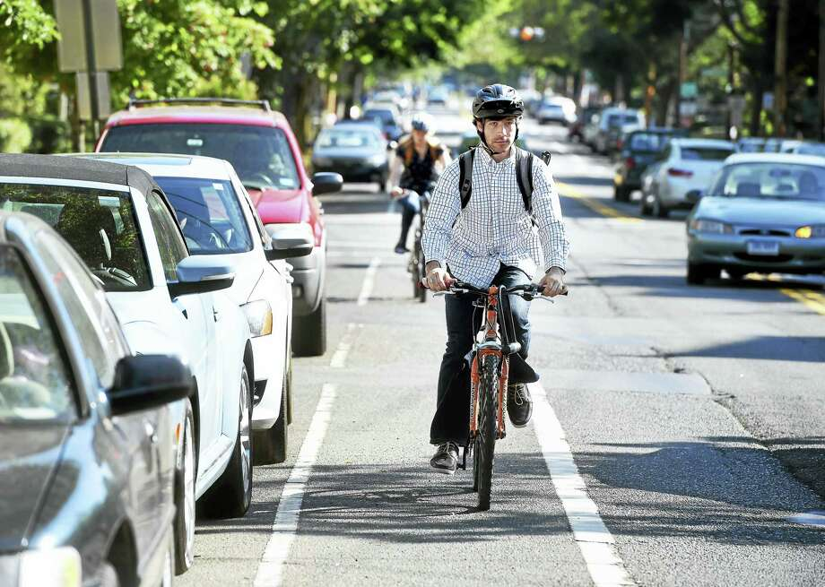 Bicyclists travel in the bicycle lane on Orange Street in New Haven in June. Photo: Arnold Gold-New Haven Register