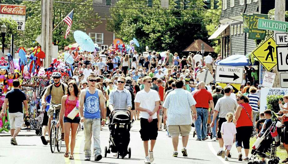 A large crowd enjoys the Oyster Festival in Milford a few years ago. Photo: Peter Hvizdak — Register   / ©Peter Hvizdak /  New Haven Register?