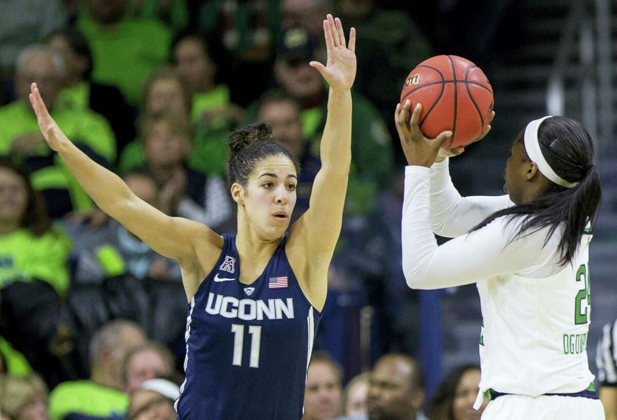 Connecticut's Kia Nurse (11) tries to block a shot by Notre Dame's Arike Ogunbowale (24) during the Huskies' 72-61 win Wednesday in South Bend, Ind.