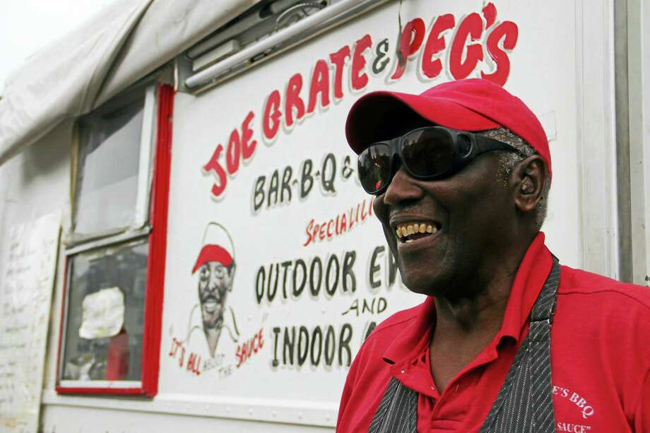 Joe Grate, owner and operator of Joe Grate's BBQ in New Haven, stands outside his truck, Joe Grate & Pegs, near Ingalls Ring in New Haven. Esteban L. Hernandez New Haven Register Photo: Journal Register Co.