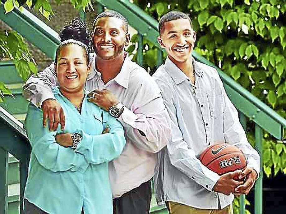 CATHERINE AVALONE — NEW HAVEN REGISTER  From left, Vanessa, Edward and Tremont Waters of New Haven. Photo: Digital First Media