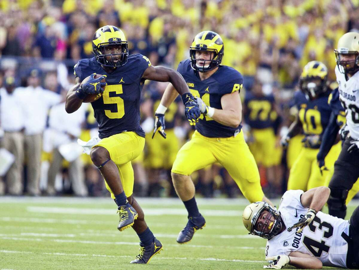 Michigan linebacker Jabrill Peppers returns a punt for a touchdown in the second half Saturday.