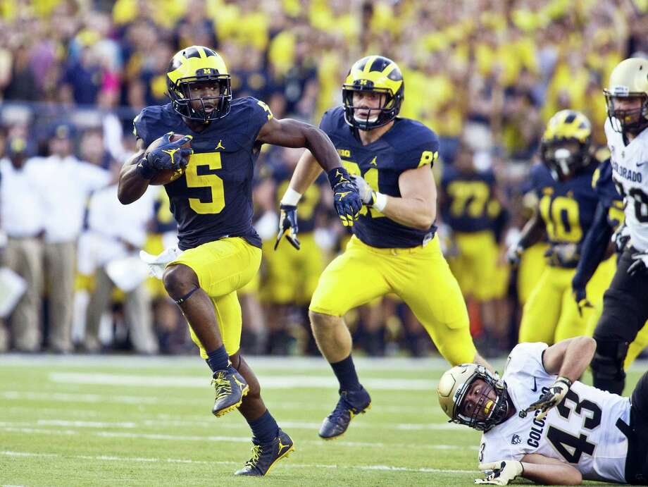 Michigan linebacker Jabrill Peppers returns a punt for a touchdown in the second half Saturday. Photo: The Associated Press    / FR143848 AP