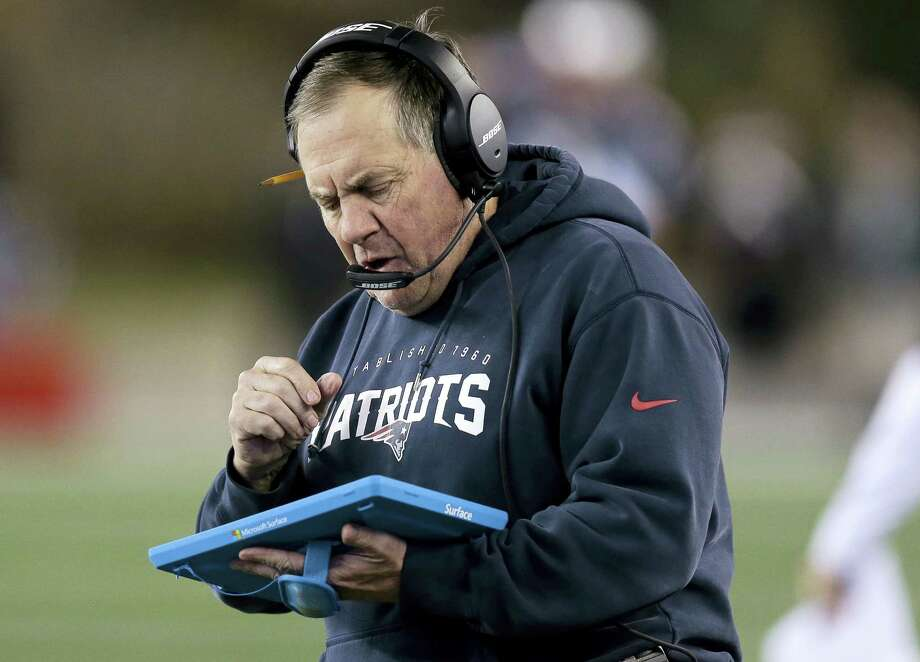 Bill Belichick studies a tablet device during a Patriots' game against the Eagles last December. Photo: The Associated Press File Photo    / Copyright 2016 The Associated Press. All rights reserved.