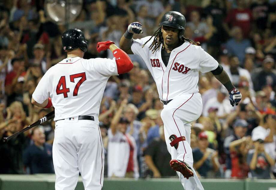 Hanley Ramirez celebrates his solo home run with Travis Shaw (47) during the seventh inning Sunday. Photo: Michael Dwyer — The Associated Press   / AP