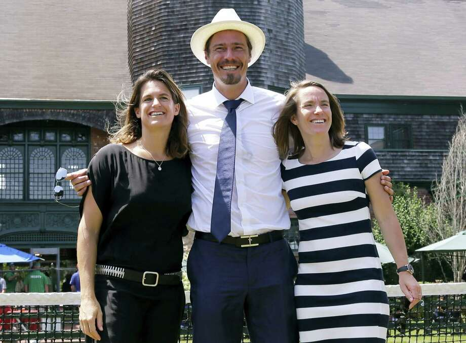 From left, Amelie Mauresmo, Marat Safin, and Justine Henin pose for photos during the enshrinement ceremony at the International Tennis Hall of Fame on Saturday in Newport, R.I. Photo: Elise Amendola — The Associated Press   / AP