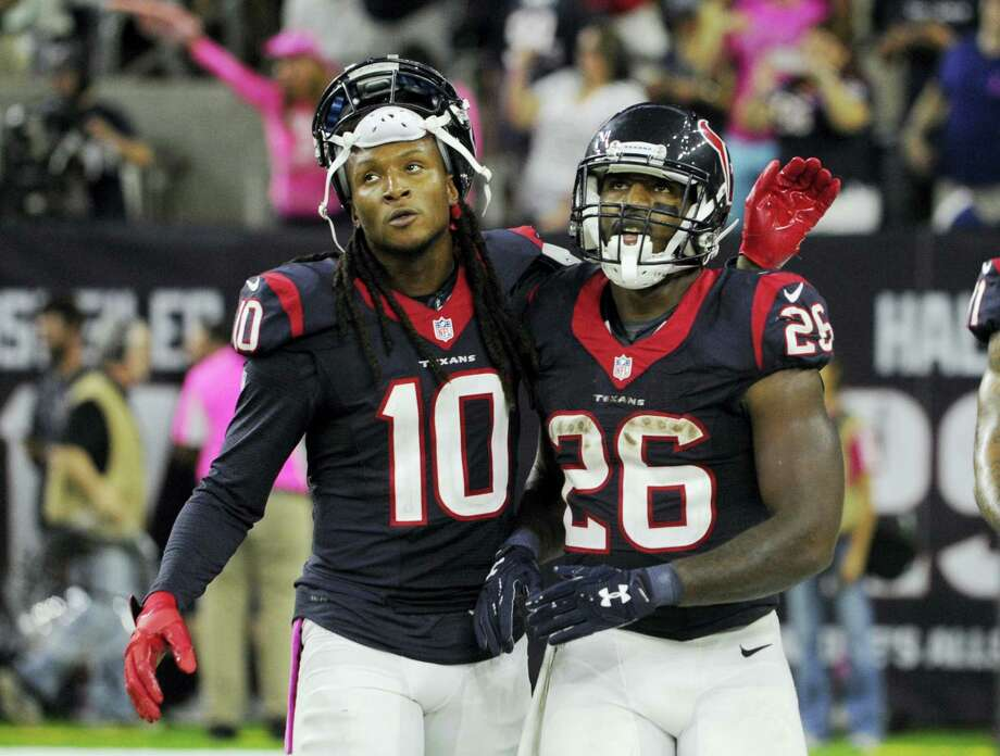 Texans wide receiver DeAndre Hopkins (10) and running back Lamar Miller (26) walk off the field during the second half of Sunday's game against the Indianapolis Colts. Photo: Eric Christian Smith — The Associated Press   / FR171023 AP