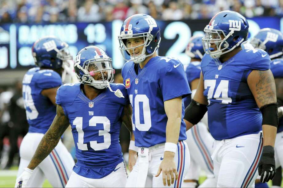 Giants wide receiver Odell Beckham (13) and Eli Manning (10) celebrate during Sunday's win over the Ravens. Photo: Bill Kostroun — The Associated Press   / FR51951 AP