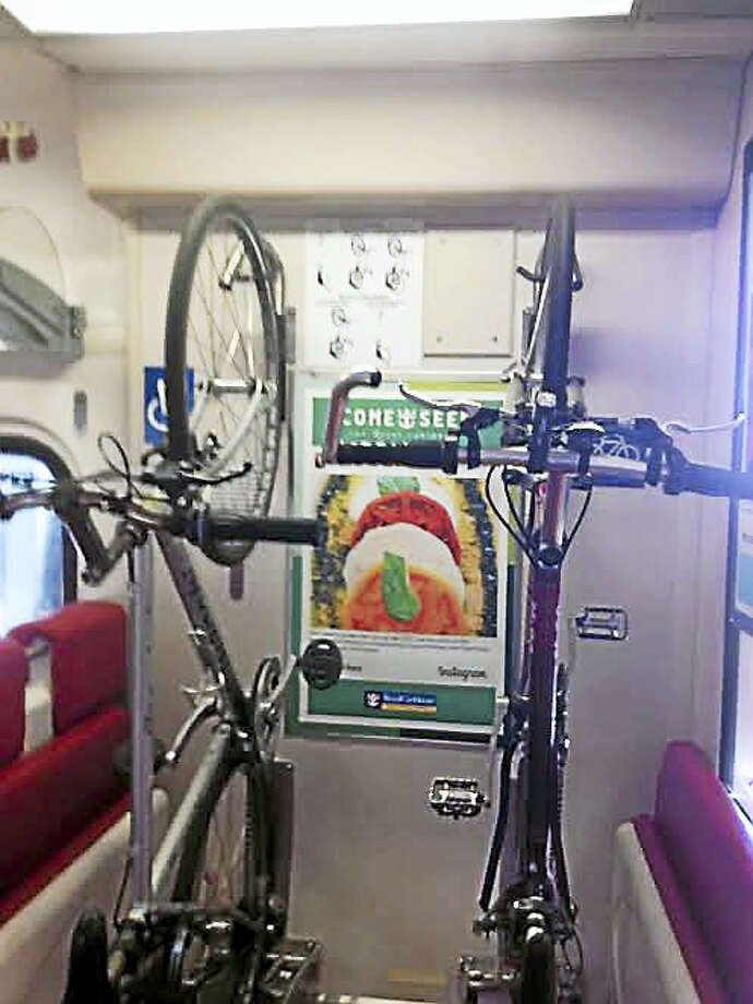 Example of a bike rack on a Metro North train. There are now 190 in train cars. Photo: MARY O'LEARY — NEW HAVEN REGISTER