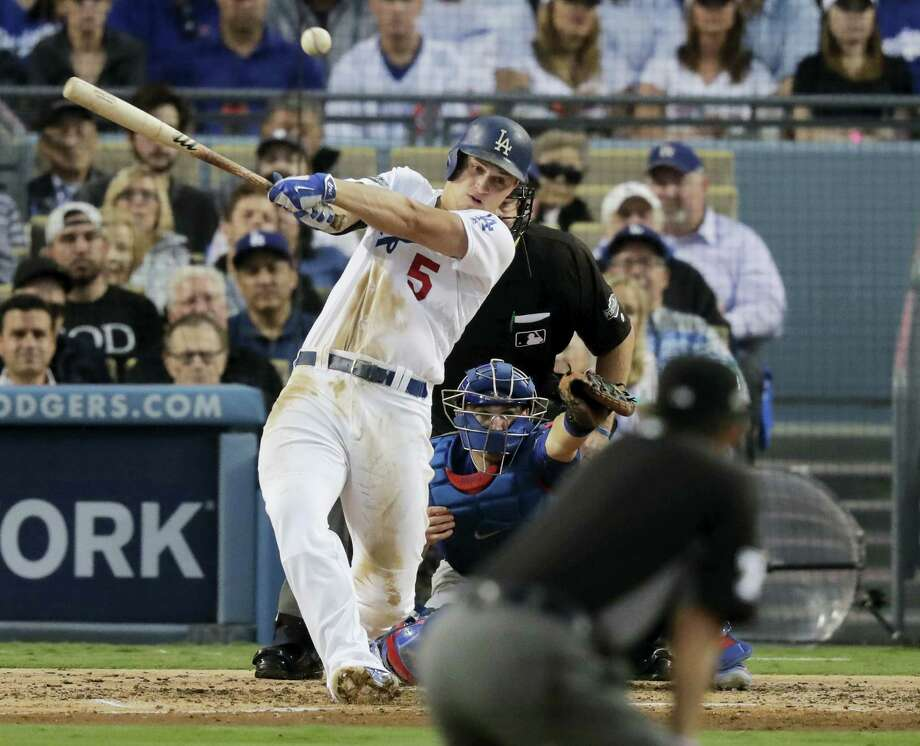 The Dodgers' Corey Seager hits an RBI single during the third inning on Tuesday. Photo: Jae C. Hong — The Associated Press   / Copyright 2016 The Associated Press. All rights reserved.