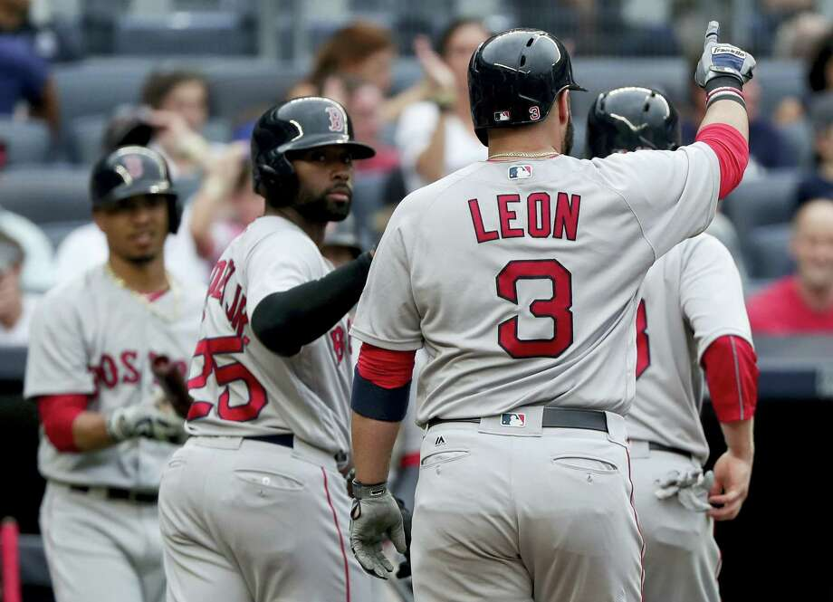 Sandy Leon (3) gestures as he heads to the dugout after hitting a three-run home run in the sixth inning Saturday. Photo: Julie Jacobson — The Associated Press   / Copyright 2016 The Associated Press. All rights reserved. This material may not be published, broadcast, rewritten or redistribu