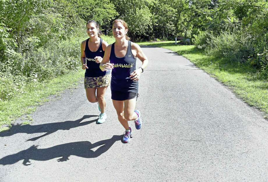 Stephanie Turbett, left, and Lauren Cieslewski run on the Quinnipiac Linear Trail in Wallingford recently. Photo: Arnold Gold — New Haven Register