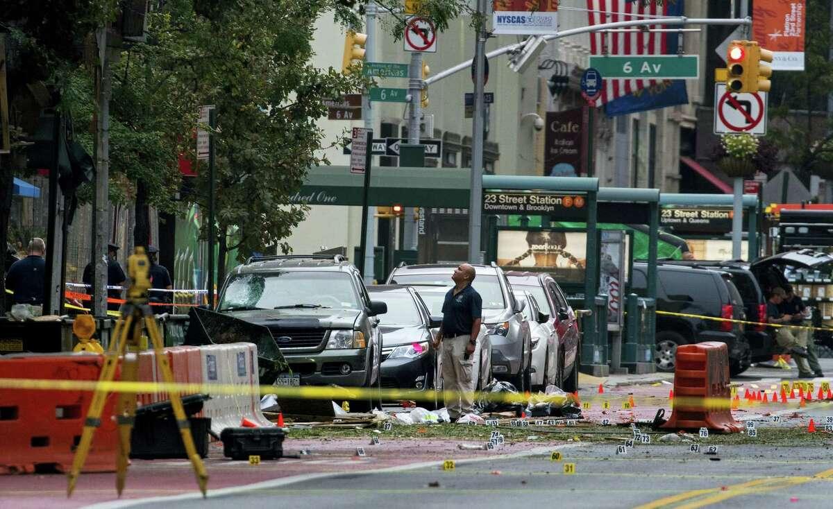 Crime scene investigators work at the scene of Saturday's explosion in Manhattan's Chelsea neighborhood in New York on Sept. 18, 2016.