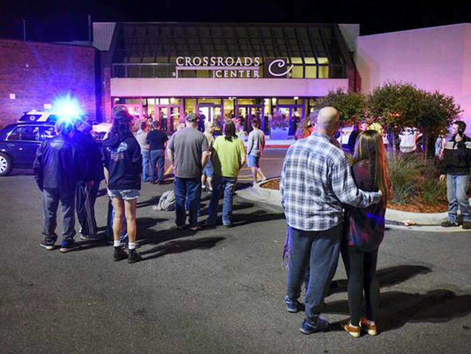 People stand near the entrance on the north side of Crossroads Center mall between Macy's and Target as officials investigate a reported multiple stabbing incident on Sept. 17, 2016, in St. Cloud, Minn. Police said multiple people were injured at the St. Cloud shopping mall on Saturday evening in an attack possibly involving both shooting and stabbing. The suspect is believed to be dead, St. Cloud Police Sgt. Jason Burke told the St. Cloud Times. Photo: Dave Schwarz/St. Cloud Times Via AP   / St. Cloud Times