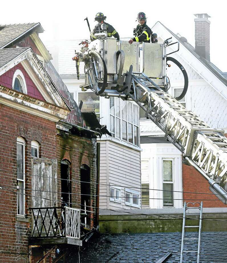 The New Haven Fire Department responds to a fire at 1187 Chapel St. in New Haven Tuesday. Photo: Arnold Gold — New Haven Register