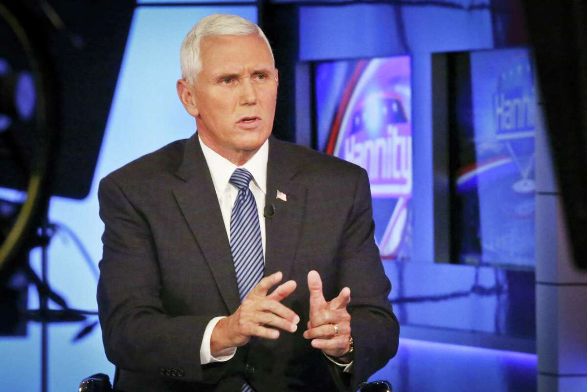 Indiana Gov. Mike Pence speaks during an interview with FOX News Channel's Sean Hannity after Donald Trump selected him for running mate on the Republican presidential ticket, Friday in New York. Pence's conservative track record on immigration dates to his earliest days in the House of Representatives and echoes the hard-line stance of his presumptive running mate on the Republican presidential ticket, Donald Trump.