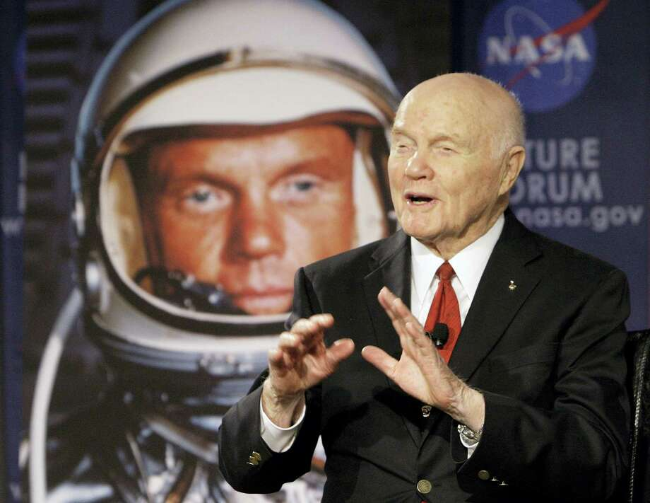 """In this file photo, U.S. Sen. John Glenn talks with astronauts on the International Space Station via satellite before a discussion titled """"Learning from the Past to Innovate for the Future"""" in Columbus, Ohio. Glenn, who was the first U.S. astronaut to orbit Earth and later spent 24 years representing Ohio in the Senate, has died at 95. Photo: Jay LaPrete — The Associated Press File   / FR52593 AP"""